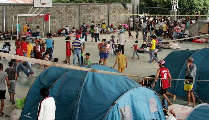 Fotografía de archivo del 24 de marzo de 2021 que muestra a migrantes venezolanos en un centro de integración ciudadana de Arauquita, localidad fronteriza y perteneciente al departamento de Arauca