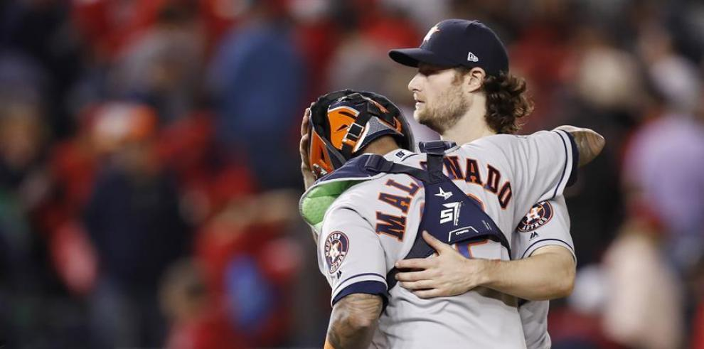 Houston Astros Gerrit Cole (R) and Martin Maldonado (L) celebrate after the final out of the game as the Astros defeated the Washington Nationals 2019.