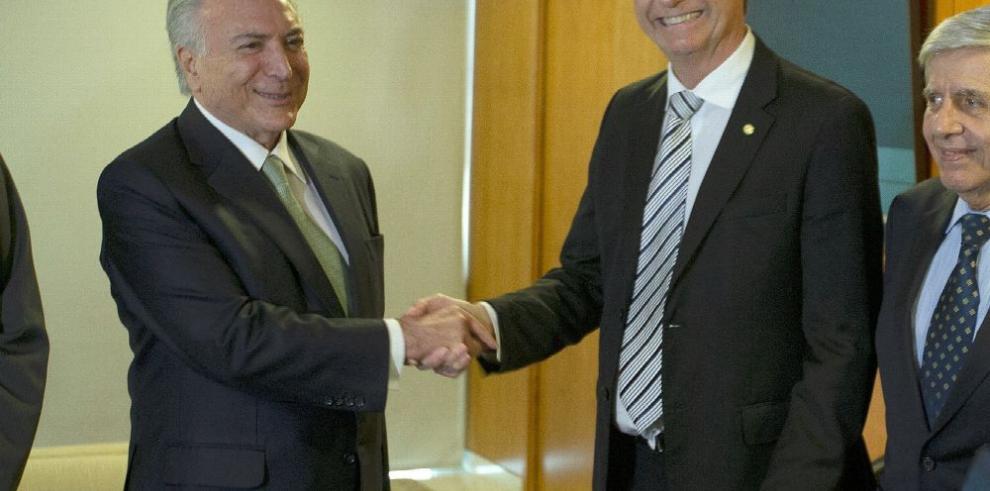 Temer 'colaborará intensamente' con Jair Bolsonaro