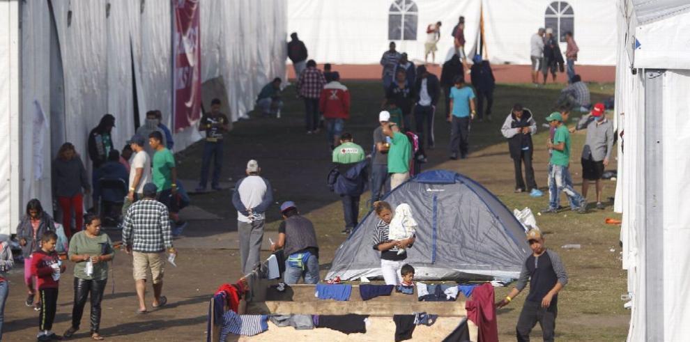 Migrantes de caravana esperan reunirse con López Obrador