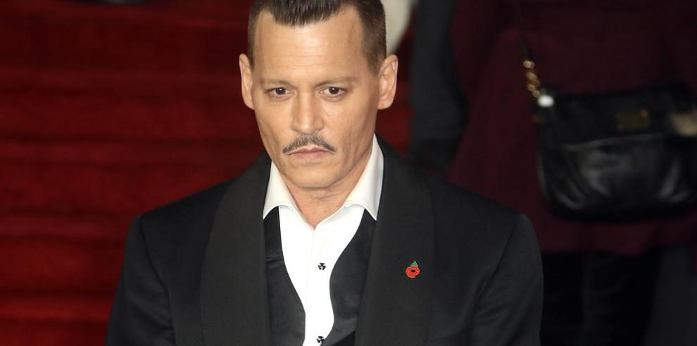 Johnny Depp evita ir a juicio