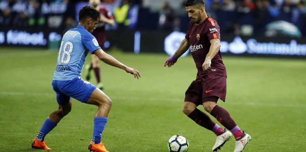 Suárez y Coutinho firman triunfo del Barcelona que hunde más al Málaga