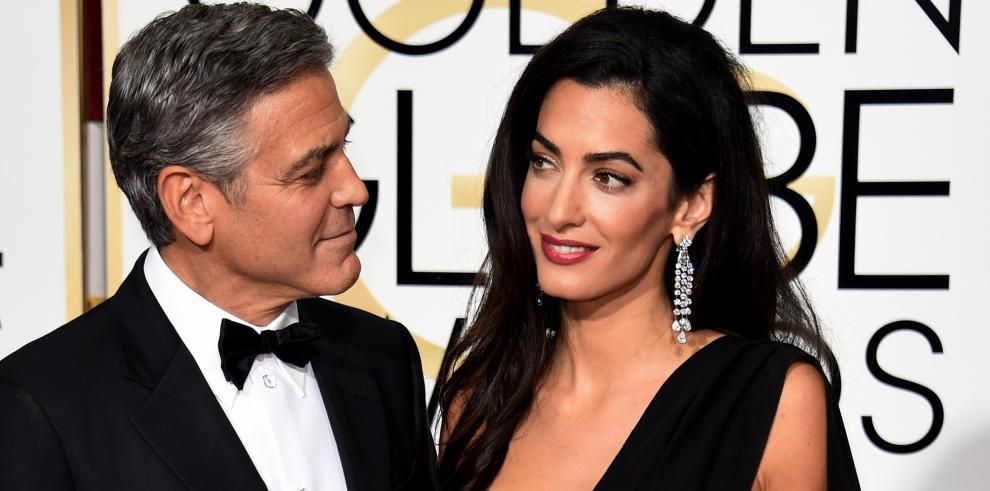 Los Clooney donan medio millón de dólares al movimiento March For Our Lives