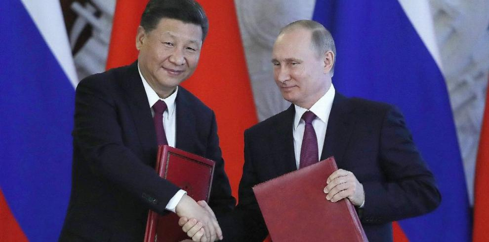 Putin y Xi acuerdan promover diálogo para Pyongyan
