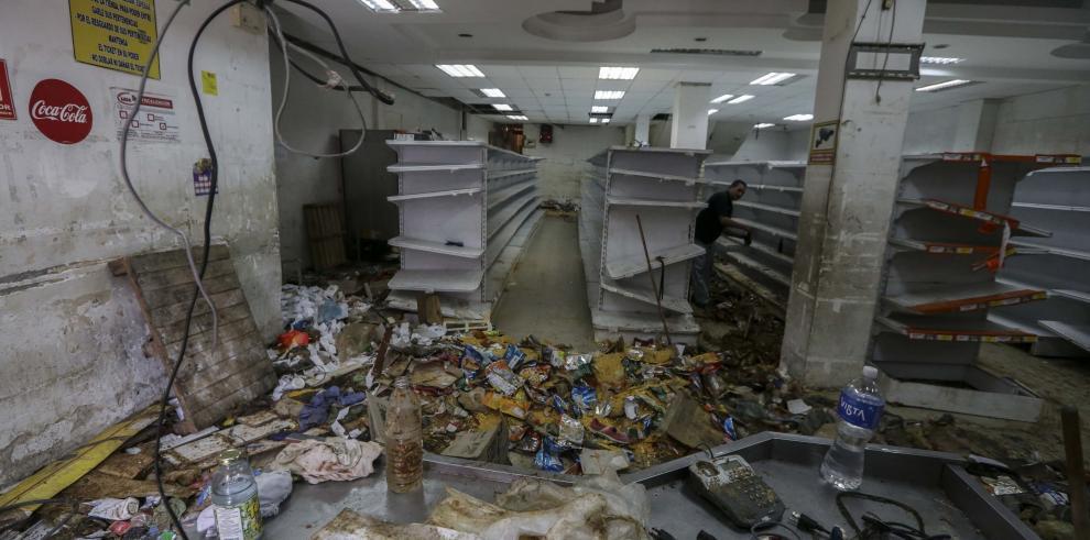 Una docena de comercios saqueados en la zona de Caracas donde hubo 11 muertos