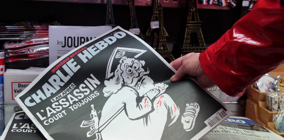 Un dios asesino en la portada de Charlie Hebdo, año después del atentado