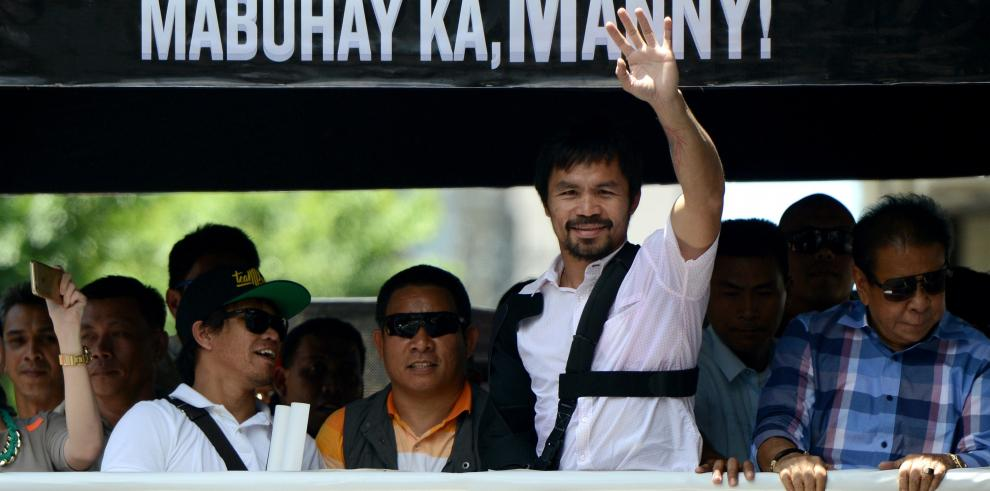 Discreto regreso a Filipinas de Pacquiao, cuya retirada