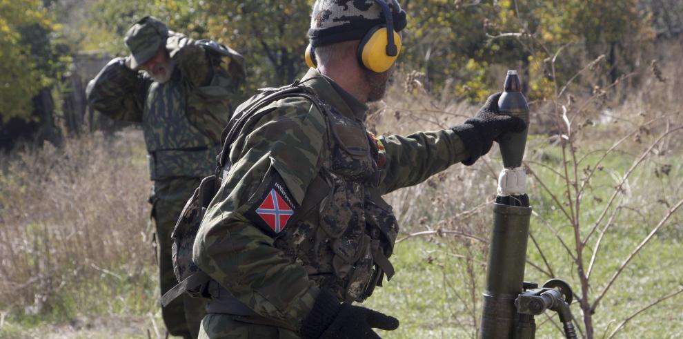 Los combates recrudecen en Ucrania en víspera de reunión Putin-Poroshenko
