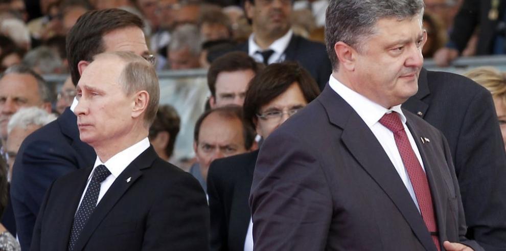 Putin se reune por primera vez con el presidente ucraniano