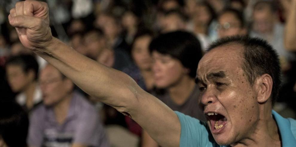 China aprueba voto universal, pero condiciona los candidatos
