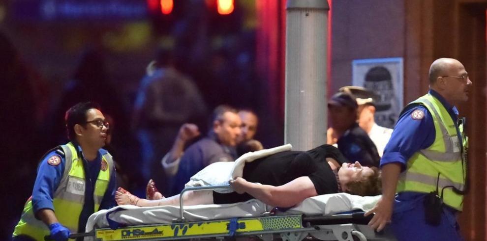4 heridos entre los rehenes del secuestro de un café en Sidney
