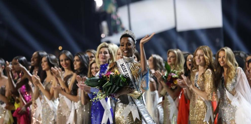 Miss South Africa Zozibini Tunzi (C) is crowned Miss Universe 2019