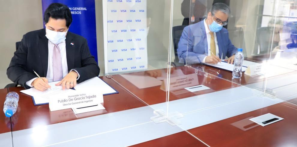 n acuerdo para facilitar el pago de impuestos, firmó el director de la DGI, Publio De Gracia y el Gerente General de Visa, Santiago Rega.   .